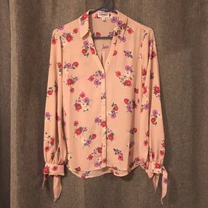 Floral patterned, button up shirt.